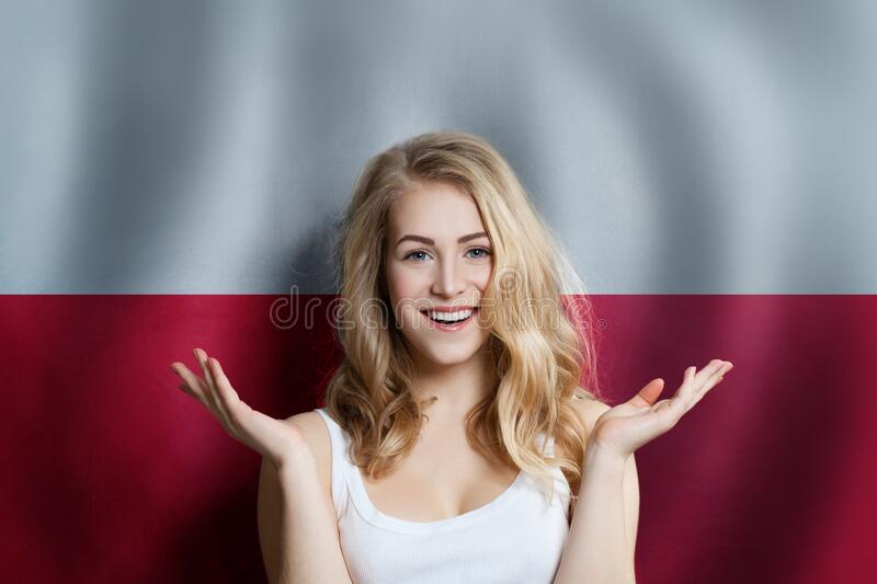 Poland concept with happy Surprised cute girl with Polish flag background. Travel and education concept.  royalty free stock photo
