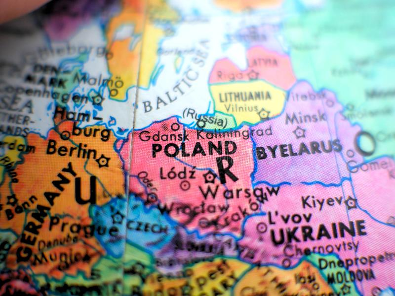 Poland focus macro shot on globe map for travel blogs, social media, website banners and backgrounds. Poland focus macro shot on globe map for travel blogs royalty free stock photo