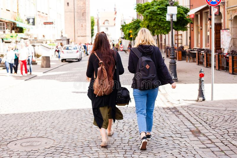 Urban life. Two young girls Walking on the Street stock photos