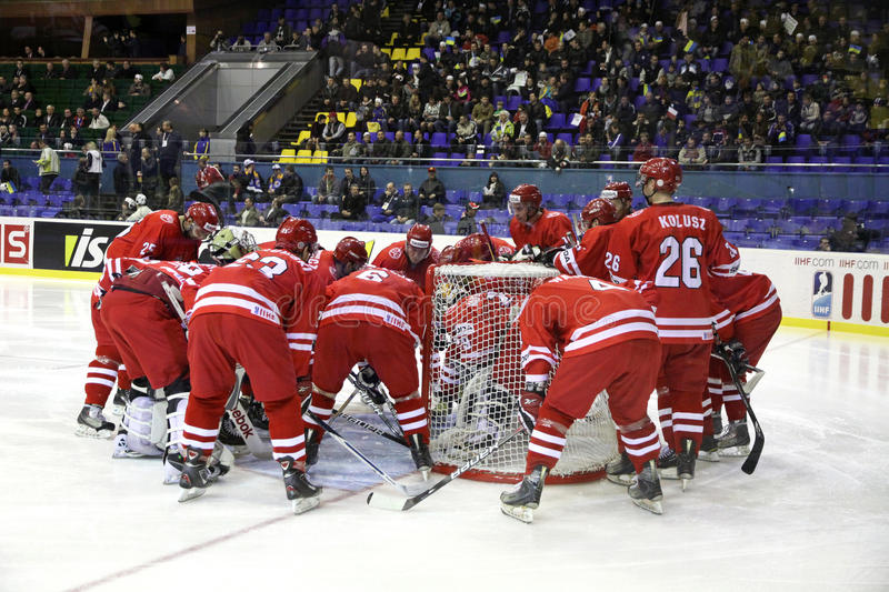 Poland ice-hockey team. KYIV, UKRAINE - APRIL 20, 2011: Poland players chear each other up during IIHF Ice-hockey World Championship DIV I Group B game against stock photography