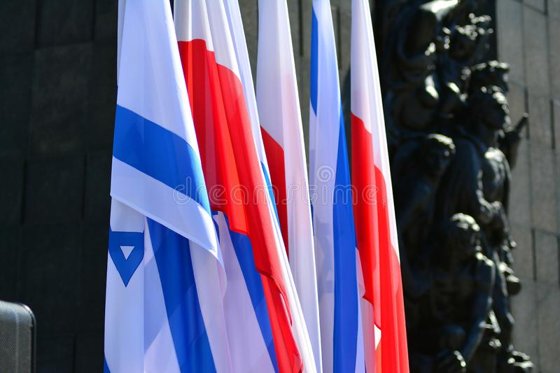 Poland and Israel flag waving in the wind. Israel and Poland two flags textile cloth. stock image
