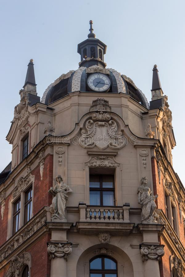 Poland, Katowice - 12/06/2018: ancient building with clock in center of city. Polish architecture landmark. Europe travel concept stock image