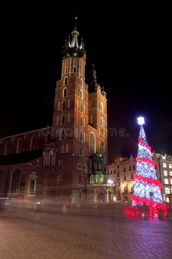Poland, Krakow, Main Market square and Cloth Hall in winter, during Christmas fairs decorated with Christmas tree. Poland, Krakow, Main Market square and Cloth royalty free stock photography