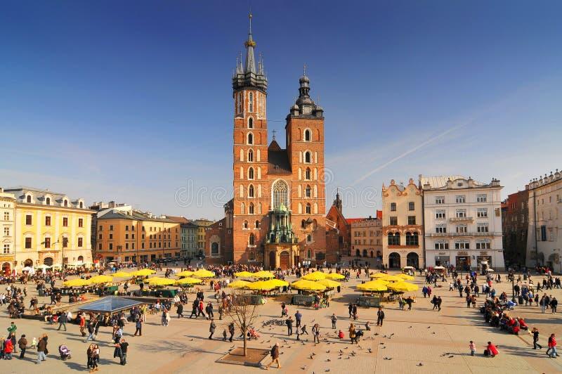 Poland, Krakow, Main Market Square, St Mary Church stock photography