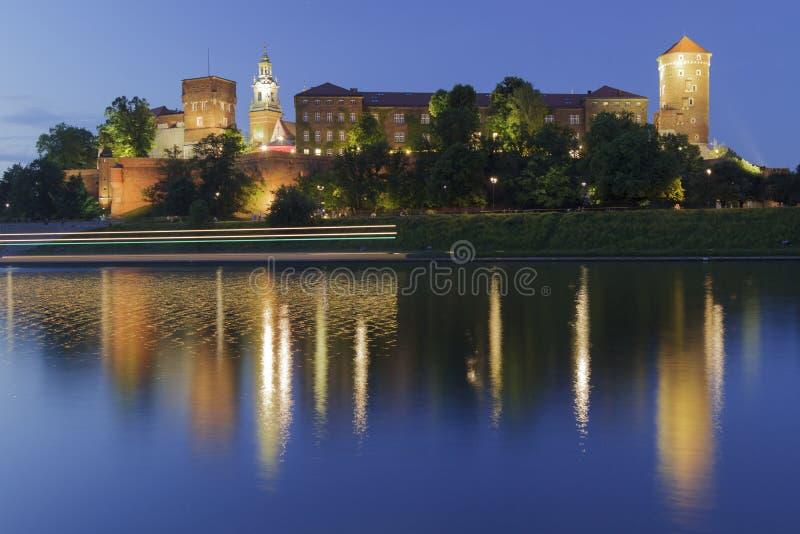 Poland, Krakow, Wawel Royal Castle, Lights Of A Passing Boat Stock Image