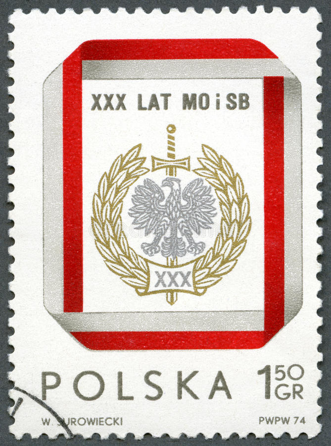 POLAND - 1974: shows Civic Militia and Security Service Badge, devoted 30th anniversary royalty free stock image