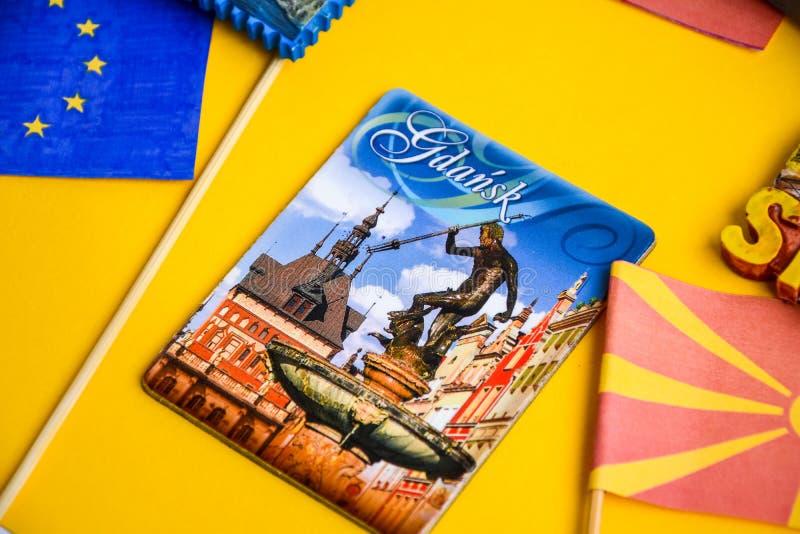Poland travel destination, polish flag, magnets from Gdansk , world map. Poland travel destination, polish flag, magnets from Gdansk, world map, travel concept stock photos