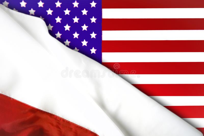 Poland and the United States. American and Polish flags. United States and Poland. Polish flag on the background of the American flag royalty free stock photography