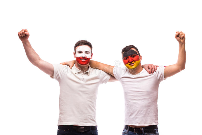 Poland vs Germany on white background. Football fans of national teams celebrate. Dance and scream. European 2016 football fans concept stock images