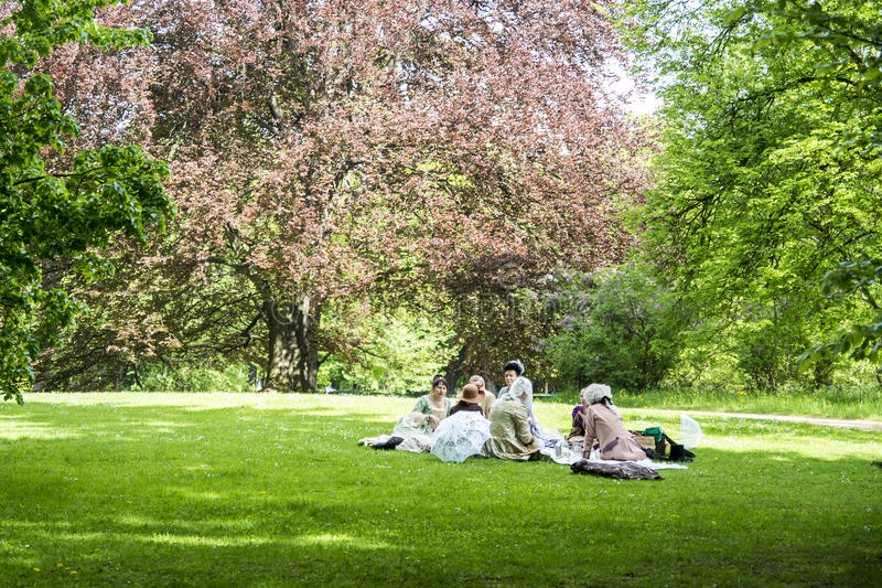 Poland - Warsaw - 09.05.2015 - The Lazienki Park people in classic clothes costumes sitting in the park acting. Poland Warsaw - 09.05.2015 - The Lazienki Park stock photos
