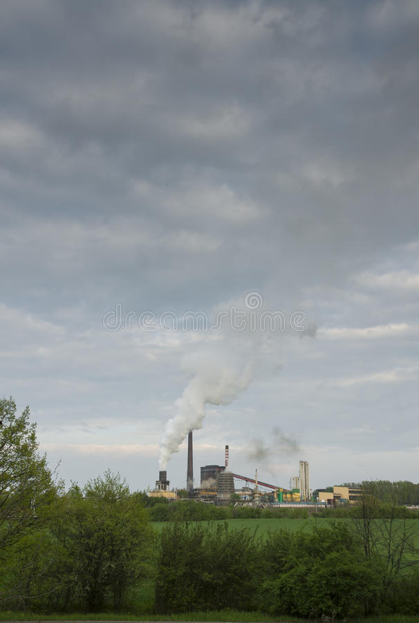 Poland, Zabrze, Biskupice Coking Plant. Seen over green field, spring stock photo