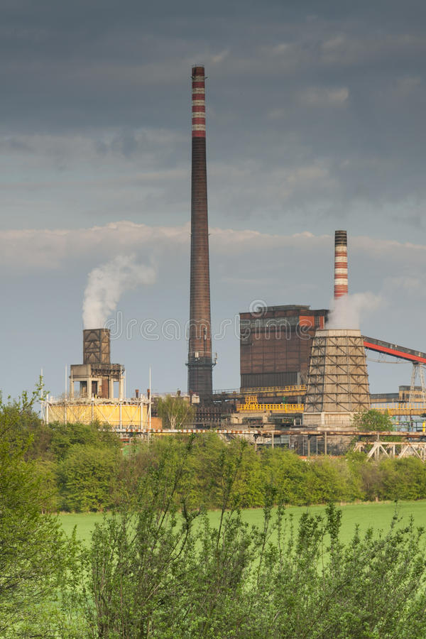 Poland, Zabrze, Biskupice Coking Plant. Seen over green field, spring stock photos