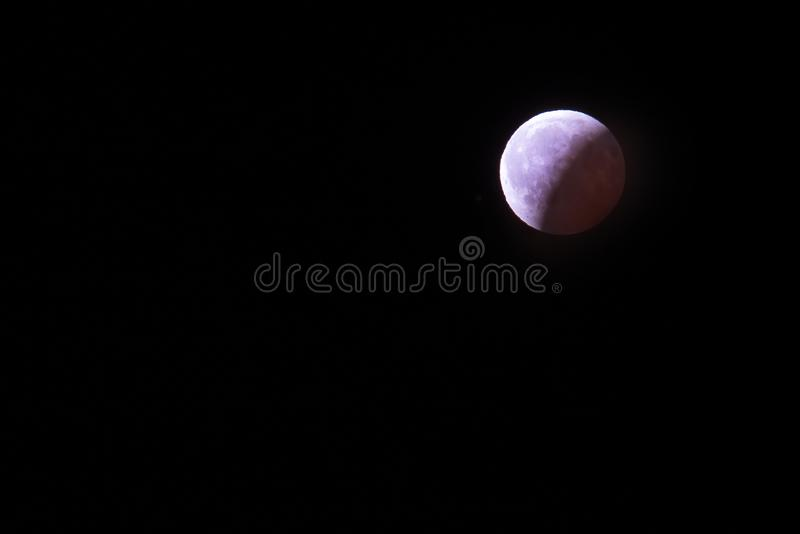 Polar arctic full red super moon eclipse sky star in Norway Svalbard in Longyearbyen city mountains. The polar arctic full red super moon eclipse sky star in royalty free stock photos