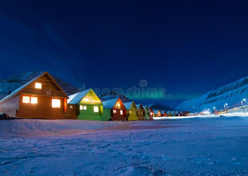 The polar arctic man Northern lights aurora borealis sky star in Norway Svalbard in Longyearbyen city moon mountains. The polar arctic man Northern lights aurora royalty free stock photography