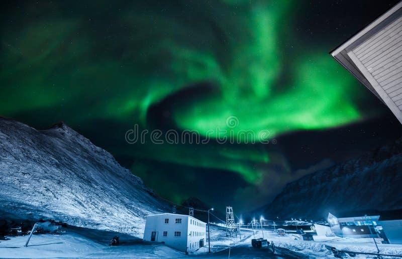 The polar arctic Northern lights aurora borealis sky star in Norway Svalbard in Longyearbyen city moon mountains. The polar arctic Northern lights aurora royalty free stock photo