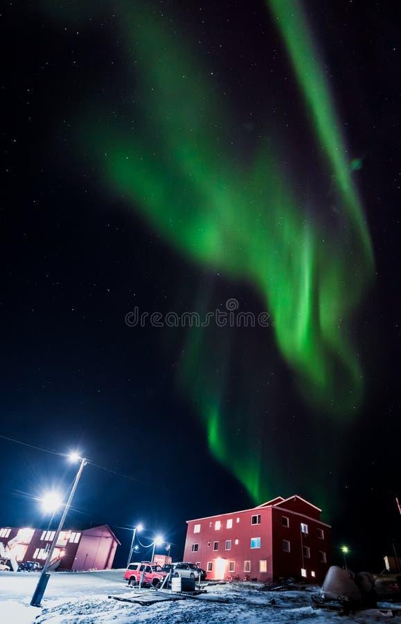The polar arctic Northern lights aurora borealis sky star in Norway Svalbard in Longyearbyen city moon mountains. The polar arctic Northern lights aurora stock photos