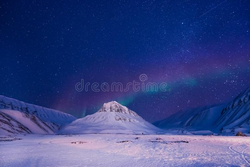 The polar arctic Northern lights aurora borealis sky star Norway Svalbard in Longyearbyen city mountains stock photo