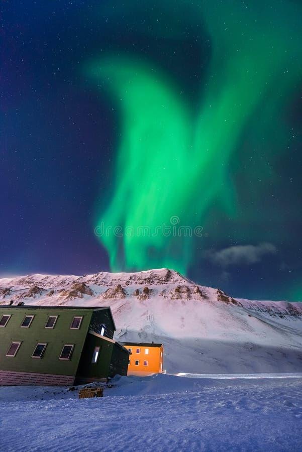 The polar arctic Northern lights aurora borealis sky star Norway Svalbard in Longyearbyen city mountains stock photo