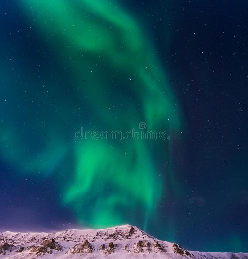 The polar arctic Northern lights aurora borealis sky star Norway Svalbard in Longyearbyen city mountains royalty free stock photo