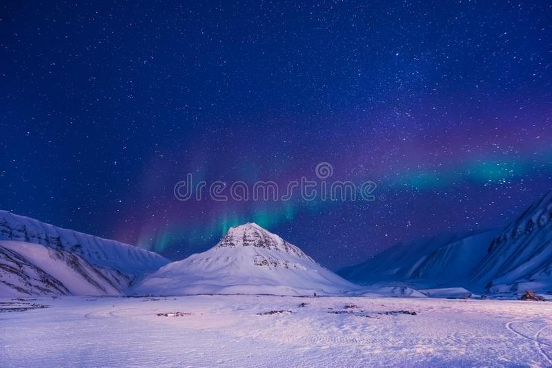 The polar arctic Northern lights aurora borealis sky star Norway Svalbard in Longyearbyen city mountains royalty free stock image