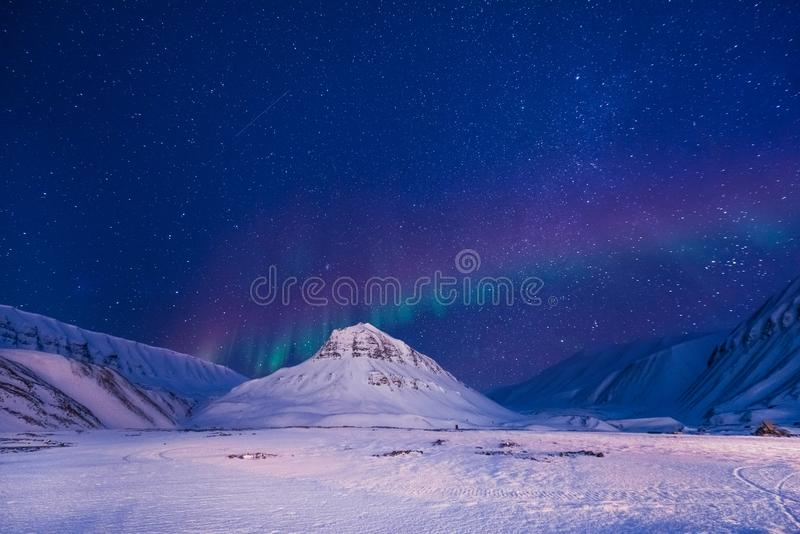The polar arctic Northern lights aurora borealis sky star Norway Svalbard in Longyearbyen city mountains stock images