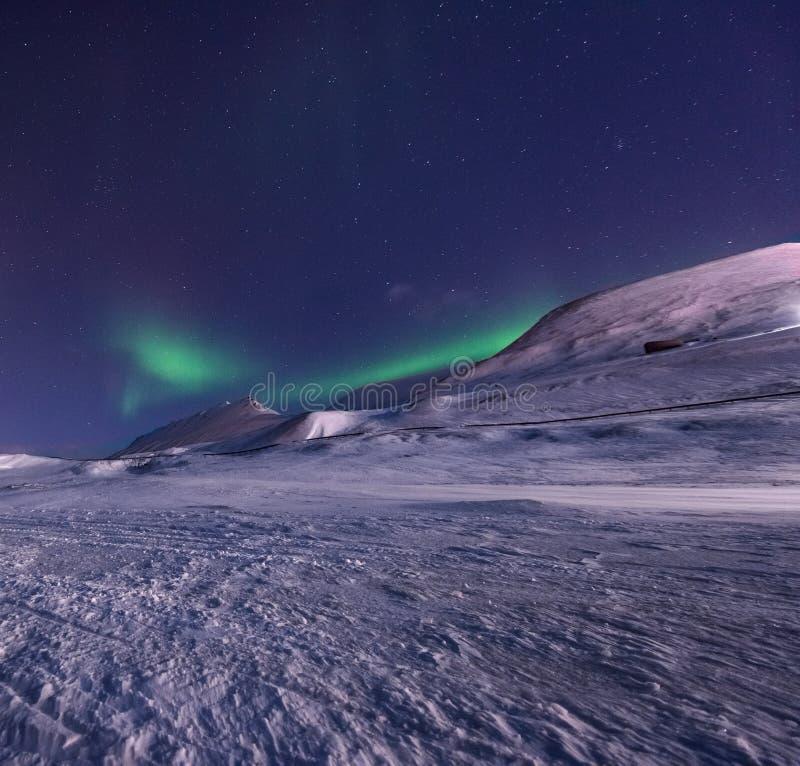 The polar arctic Northern lights aurora borealis sky star Norway Svalbard in Longyearbyen city mountains stock image