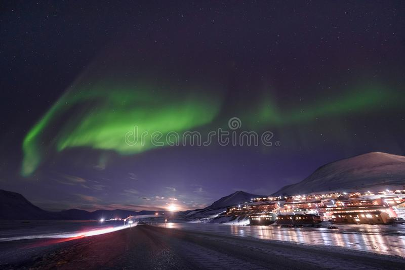 Polar arctic Northern lights aurora borealis sky star in Norway Svalbard in Longyearbyen city travel mountains stock photography