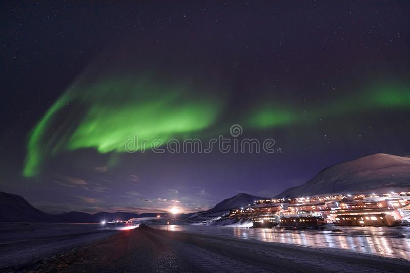 Polar arctic Northern lights aurora borealis sky star in Norway Svalbard in Longyearbyen city travel mountains stock photo