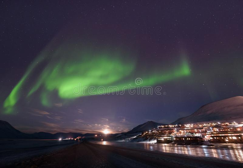 Polar arctic Northern lights aurora borealis sky star in Norway Svalbard in Longyearbyen city travel mountains royalty free stock images