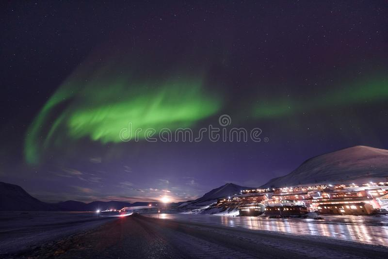 Polar arctic Northern lights aurora borealis sky star in Norway Svalbard in Longyearbyen city travel mountains. The polar arctic Northern lights aurora borealis royalty free stock images