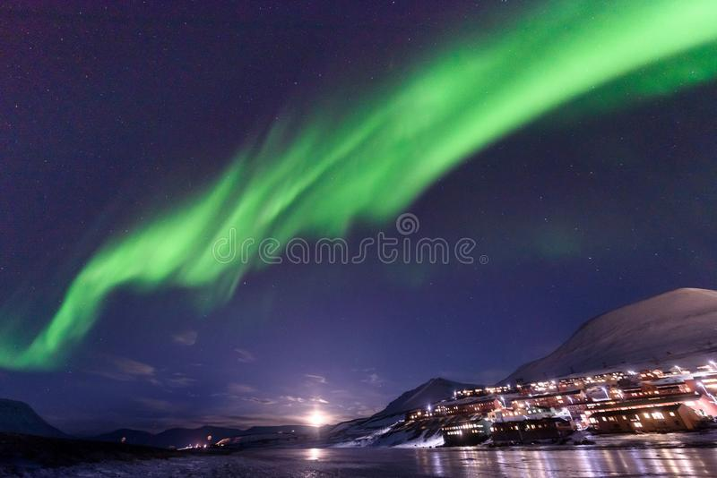 Polar arctic Northern lights aurora borealis sky star in Norway Svalbard in Longyearbyen city travel mountains. The polar arctic Northern lights aurora borealis royalty free stock image