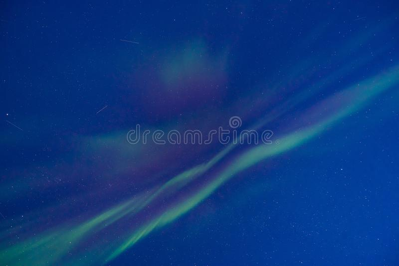 Polar arctic Northern lights aurora borealis sky star in Norway Svalbard in Longyearbyen the moon mountains. The polar arctic Northern lights aurora borealis sky stock photography