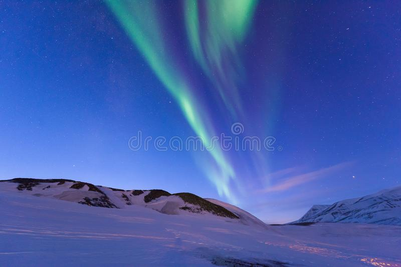 Polar arctic Northern lights aurora borealis sky star in Norway Svalbard in Longyearbyen the moon mountains stock photography