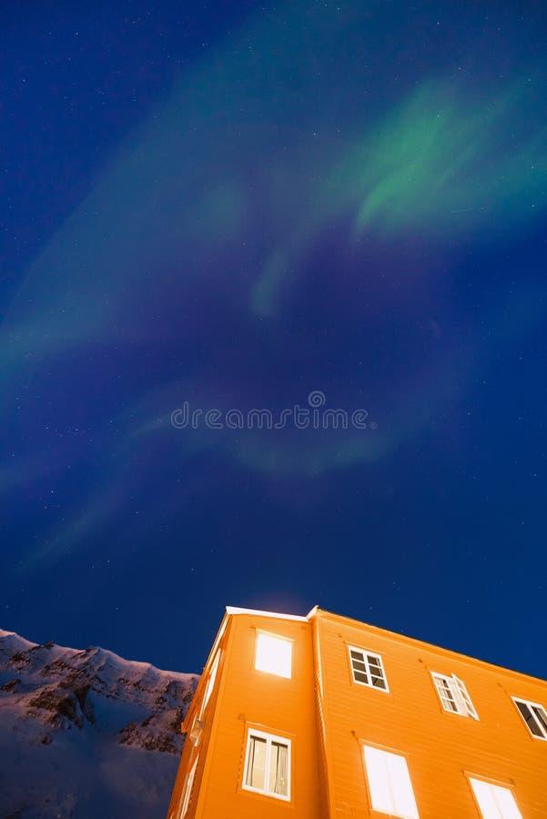 Polar arctic Northern lights aurora borealis sky star in Norway Svalbard in Longyearbyen the moon mountains stock photo