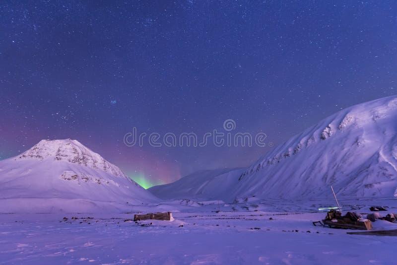 Polar arctic Northern lights aurora borealis sky star in Norway Svalbard in Longyearbyen the moon mountains. The polar arctic Northern lights aurora borealis sky stock photos