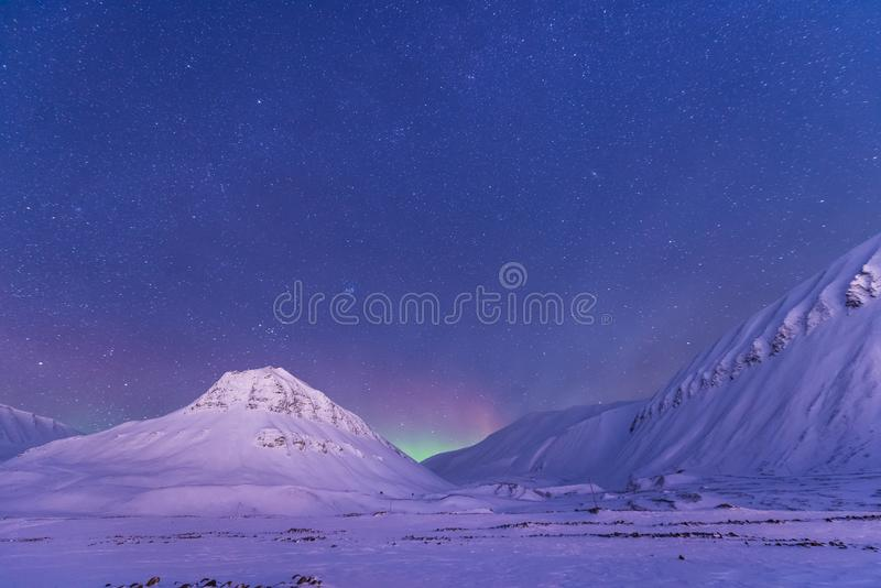 Polar arctic Northern lights aurora borealis sky star in Norway Svalbard in Longyearbyen the moon mountains. The polar arctic Northern lights aurora borealis sky royalty free stock images