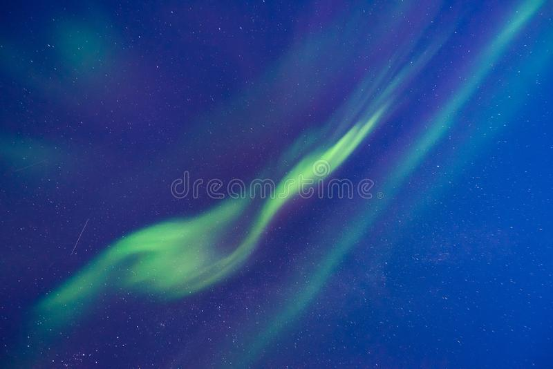 Polar arctic Northern lights aurora borealis sky star in Norway Svalbard in Longyearbyen the moon mountains royalty free stock image