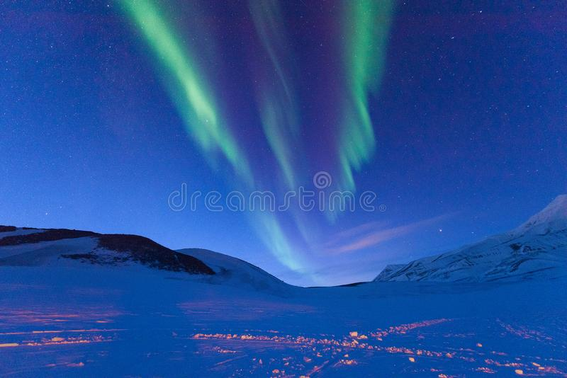 Polar arctic Northern lights aurora borealis sky star in Norway Svalbard in Longyearbyen the moon mountains. The polar arctic Northern lights aurora borealis sky royalty free stock image