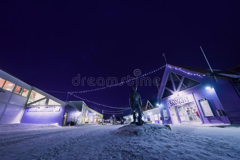 Polar arctic Northern lights aurora snowscooter borealis sky star in Norway Svalbard in Longyearbyen the moon mountains royalty free stock image