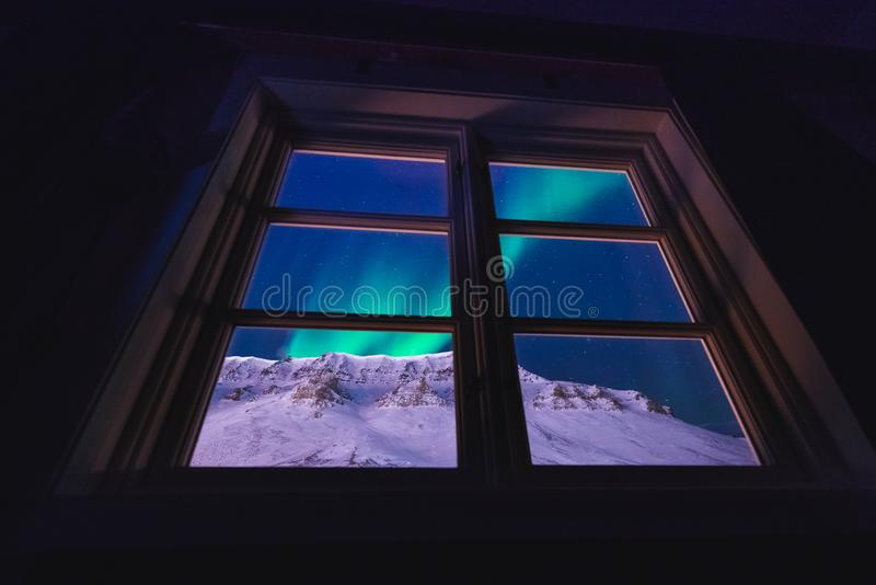 Polar arctic Northern lights aurora snowscooter borealis sky star in Norway Svalbard in Longyearbyen the moon mountains. The polar arctic Northern lights aurora royalty free stock images