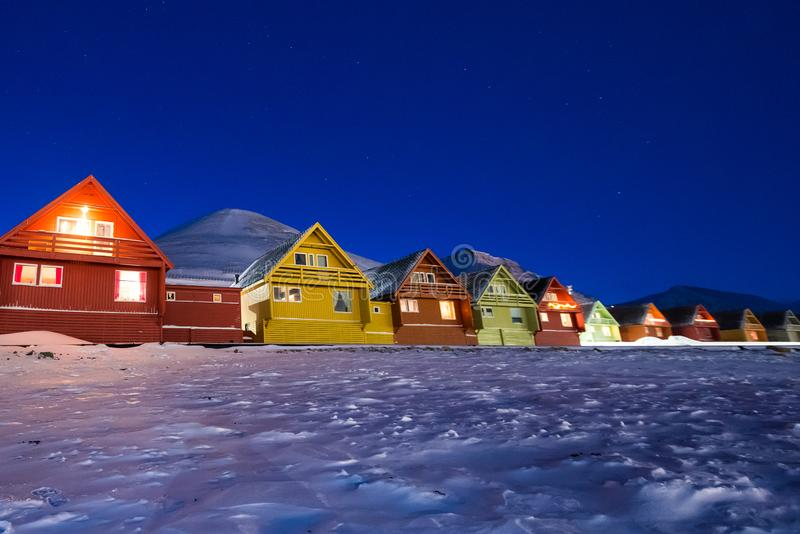 Polar arctic Northern lights aurora snowscooter borealis sky star in Norway Svalbard in Longyearbyen the moon mountains. The polar arctic Northern lights aurora royalty free stock image