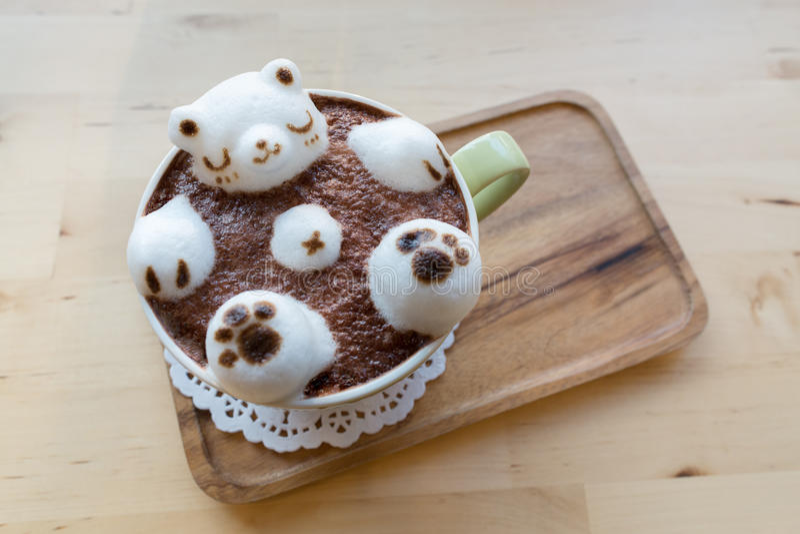 Polar bear floating in hot cappuccino stock photos