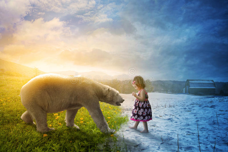 Polar bear and little girl royalty free stock images