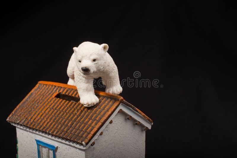 Polar bear model on a model house. Polar bear model placed on a model house royalty free stock image