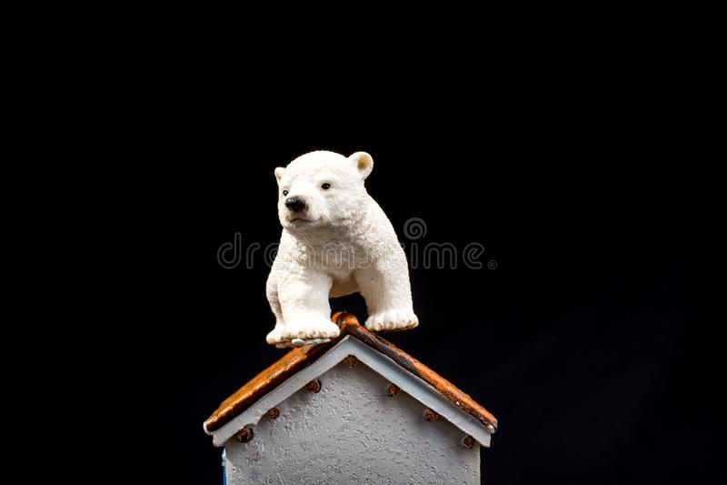 Polar bear model on a model house. Polar bear model placed on a model house royalty free stock photography