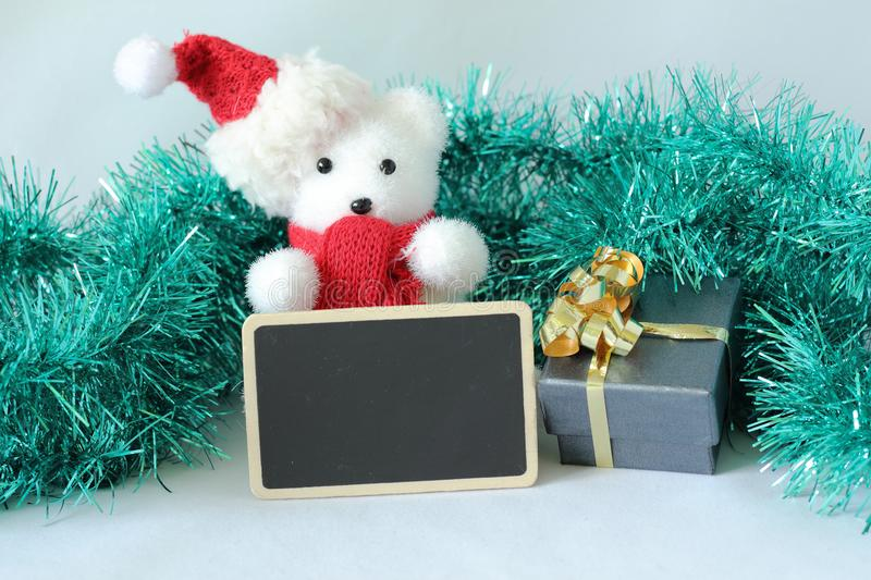 Polar bear wearing a hat and a red scarf for Christmas party decoration with a empty message slate stock images