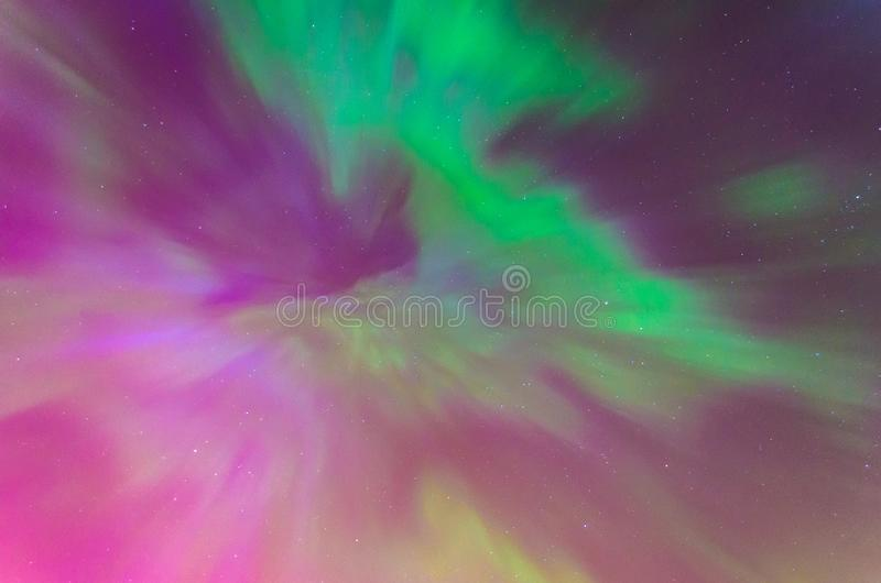 Polar lights Aurora Borealis in the night starry sky, texture and multi-colored natural phenomena. Polar lights Aurora Borealis in the night starry sky, texture royalty free stock images