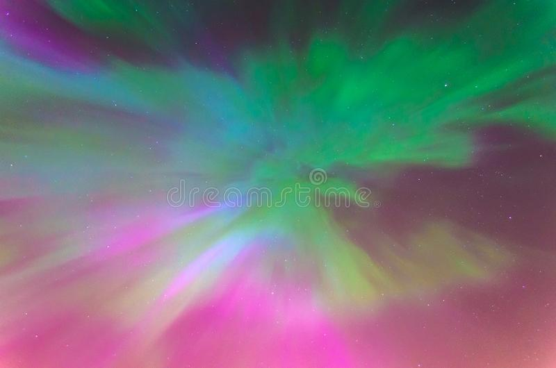 Polar lights Aurora Borealis in the night starry sky, texture and multi-colored natural phenomena. Polar lights Aurora Borealis in the night starry sky, texture royalty free stock photography