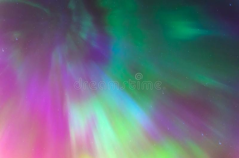 Polar lights Aurora Borealis in the night starry sky, texture and multi-colored natural phenomena. Polar lights Aurora Borealis in the night starry sky, texture stock images