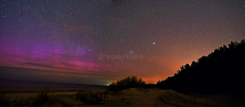 Night sky stars and aurora polar lights royalty free stock photos